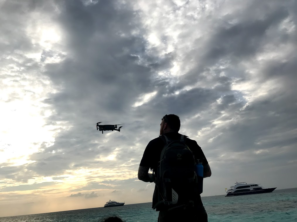 Jay and drone in the Maldives - on expedition with Dive Ninjas