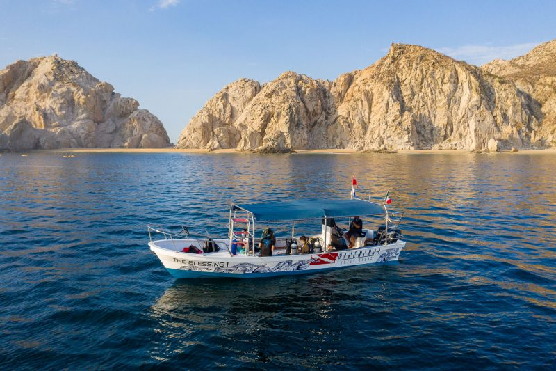 Diving with a school of fish at Neptunes Finger Cabo San Lucas